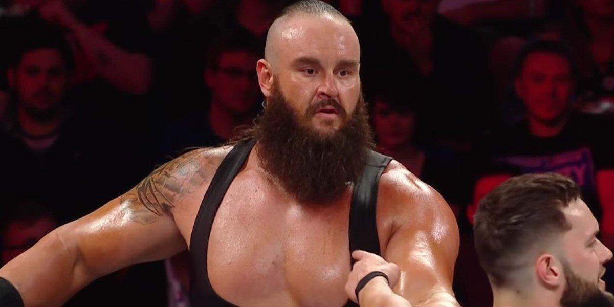 Braun Strowman looking at Finn Balor