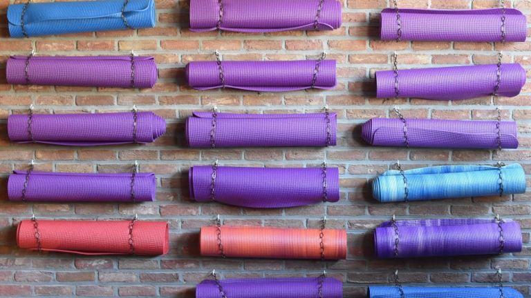 coloured yoga mats on a wall