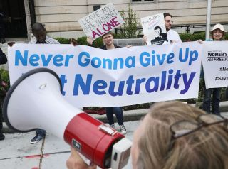 Proponents of net neutrality protest against Federal Communication Commission Chairman Ajit Pai outside the American Enterprise Institute before his arrival on May 5, 2017, in Washington, D.C.