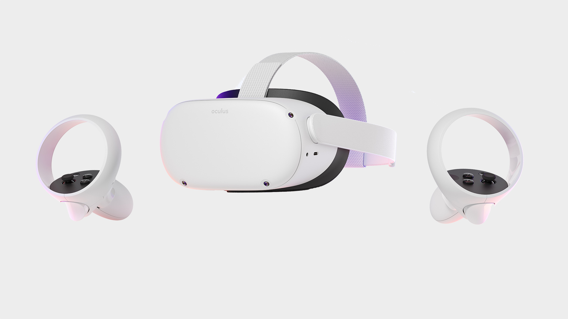 An Oculus Quest 2 pictured on a grey background with two controllers
