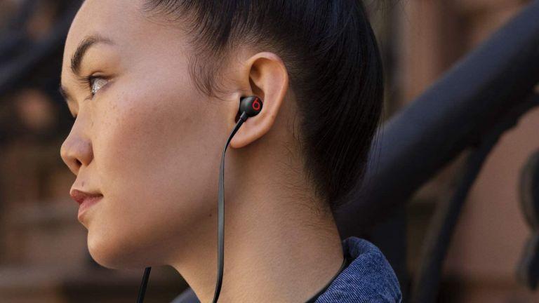 Beats Flex in woman's ears