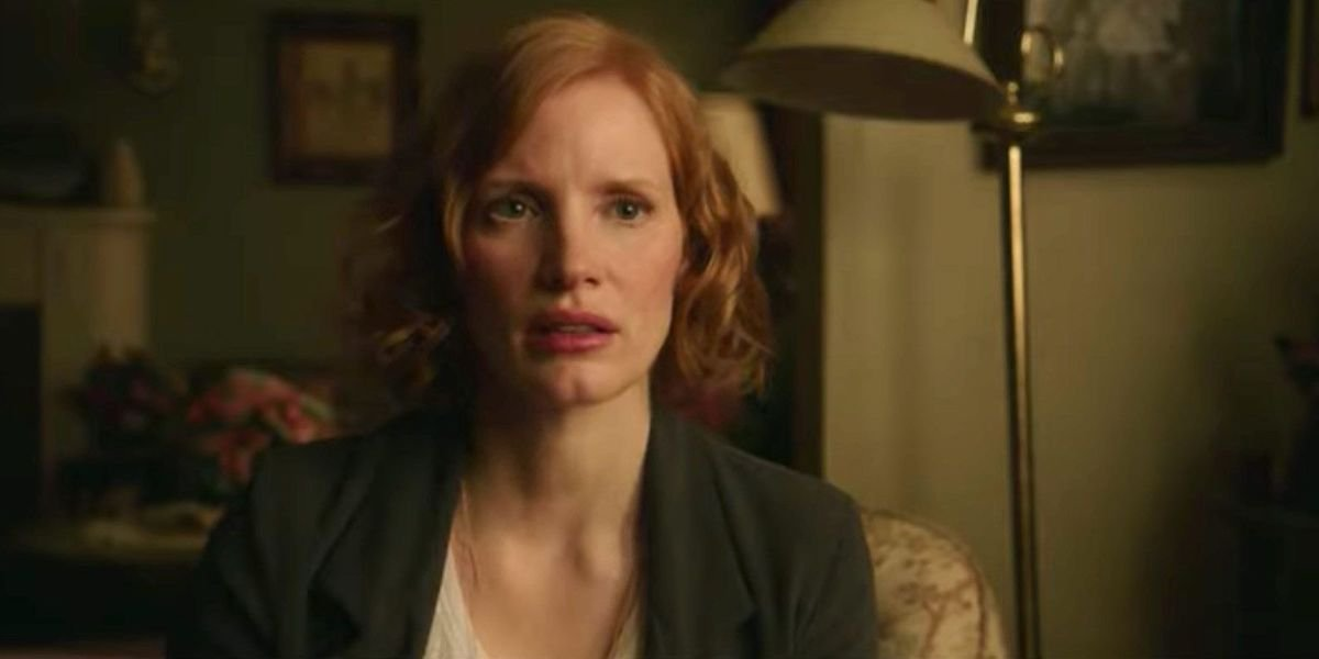 Beverly Marsh (Jessica Chastain) looks concerned while sitting in a living room in 'IT Chapter Two'