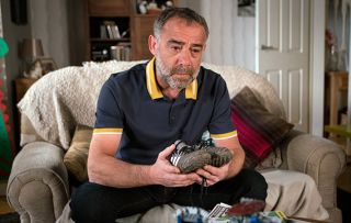 It all becomes too real for Kevin Webster as he cradles Jack's football boots.