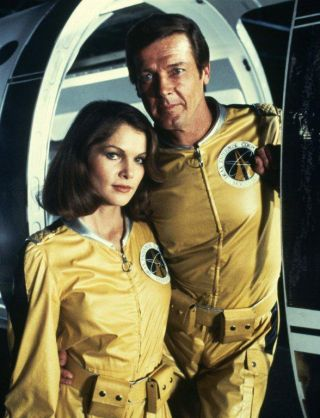 "James Bond and his CIA sidekick Holly Goodhead wear flight suits in the 1979 Bond film ""Moonraker."""