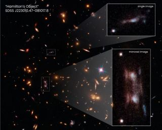 """This Hubble Space Telescope snapshot shows three magnified images of a distant galaxy embedded in a cluster of galaxies. These images are produced by a trick of nature called gravitational lensing. The galaxy cluster's immense gravity magnifies and distorts the light from the distant galaxy behind it, creating the multiple images. Two of the magnified images, shown in the pull-out at bottom right, are exact copies of each other. The two bright ovals are the cores of the galaxy. This rare phenomenon occurs because the background galaxy straddles a ripple in the fabric of space. This """"ripple"""" is an area of greatest magnification, caused by the gravity of dense amounts of dark matter."""