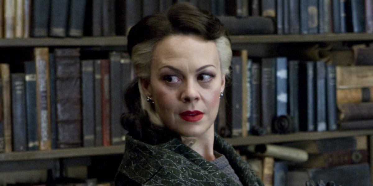 Helen McCrory as Narcissa Malfoy, standing in a study, in Harry Potter.