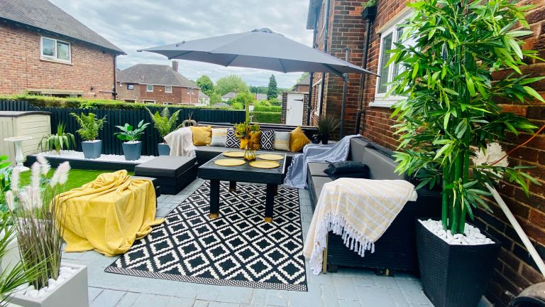 outdoor living space with seating and rug