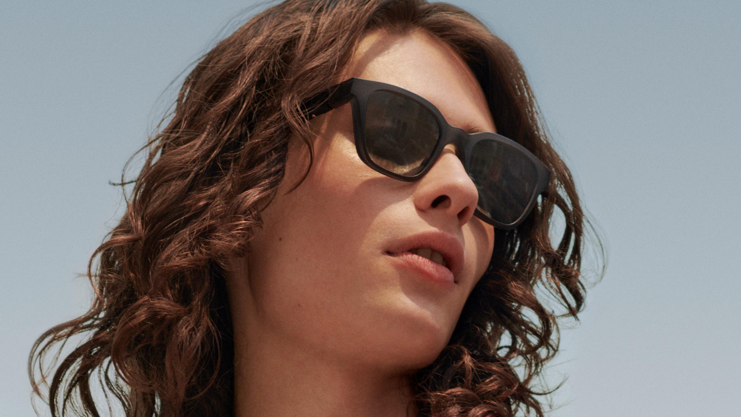 Woman wearing Bose Frames