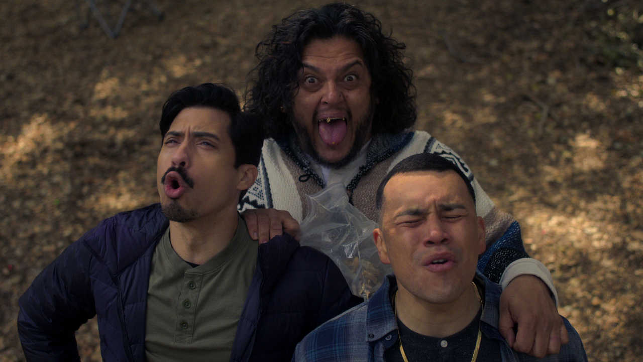 Chris Santos, Felipe Esparza, and J.J. Soria making noise in the woods in Gentefied.