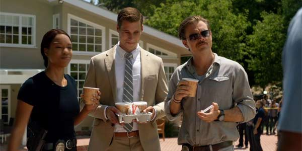 Bowman offering soup to Riggs on Lethal Weapon