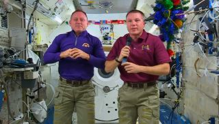 "NASA astronauts Barry ""Butch"" Wlimore (left) and Terry Virts discuss Christmas plans aboard the International Space Station during an interview on Dec. 22, 2014."