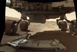 """The Perseverance rover's newly dropped """"belly pan"""" sits on the surface of Mars. The Perseverance team posted this photo on Twitter on March 13, 2021."""