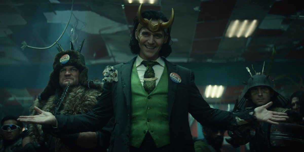 Loki smiles with delight with his allies