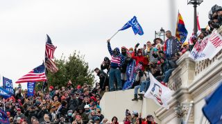 Demonstrators swarm the U.S. Capitol building during a protest in Washington, D.C., U.S., on Wednesday, Jan. 6, 2021.