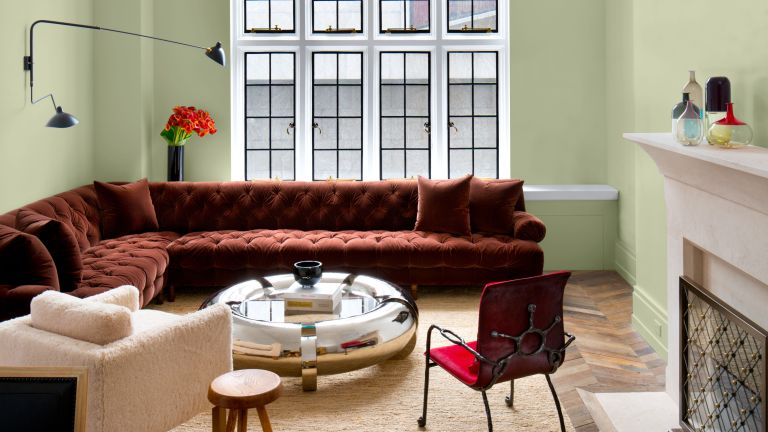 red sofa and coffee table in green living room