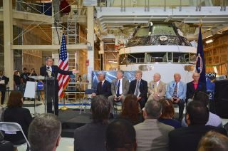 Robert Cabana, the director of NASA's Kennedy Space Center in Florida, presides over the July 21, 2014 ceremony to rename the center's historic Operations and Checkout Building for astronaut Neil Armstrong. Seated from left to right: Charles Bolden, NASA