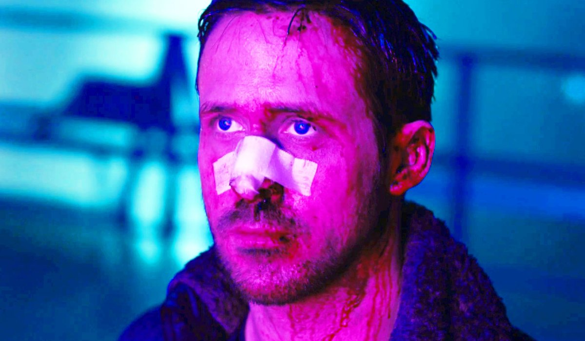 Blade Runner 2049 Ryan Gosling beaten up, bathed in pink light
