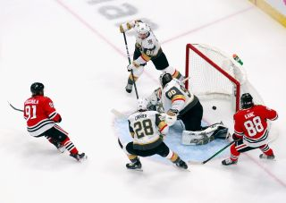 Drake Caggiula #91 of the Chicago Blackhawks (L) scores a first period goal against Robin Lehner #90 of the Vegas Golden Knights in Game Four of the Western Conference First Round during the 2020 NHL Stanley Cup Playoffs at Rogers Place on Aug. 16, 2020 in Edmonton, Alberta, Canada.