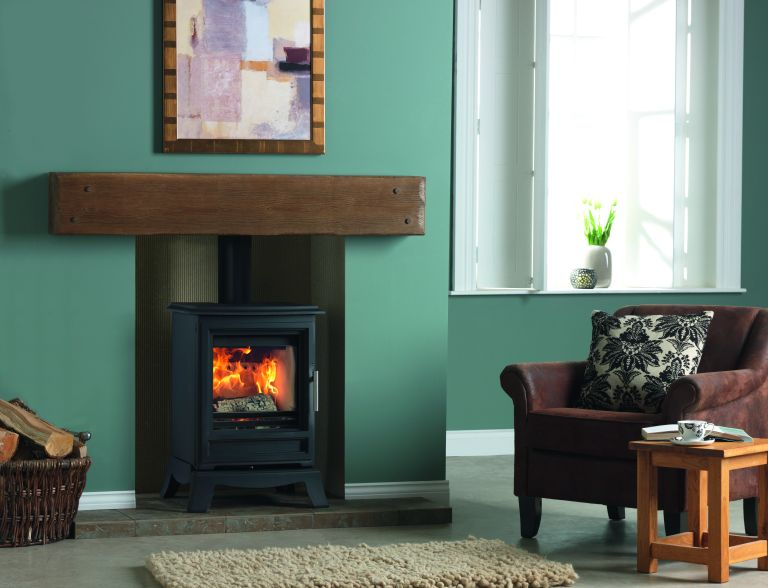 How to clean a wood burning stove: traditional woodburning stove in living room from purevision