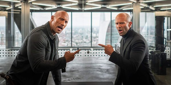 Hobbs & Shaw pointing at each other, calling each other out in a conference room