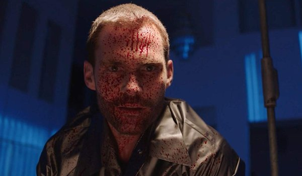 Bloodline Seann William Scott stares in awe with blood splattered on his face