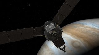 This artist's rendering shows NASA's Juno probe at Jupiter, with its solar arrays and main antenna pointed toward the sun and Earth.