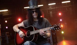 Slash with his new Epiphone Slash Collection J-45 acoustic guitar in Vermillion Burst