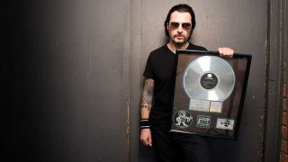 The former White Zombie drummer with his platinum disc for Astro Creep: 2000