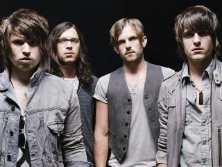 Matthew (left) and Caleb (third from left) speak to MusicRadar