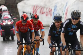 Pello Bilbao with Damiano Caruso behind DSM's Romain Bardet in the escape group on stage 20