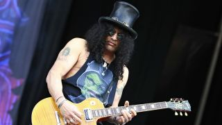 Slash playing guitar onstage at Download Festival