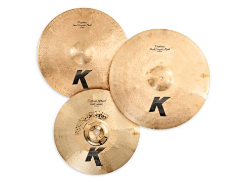 "Zildjian's two new K Custom rides (top) are medium-thin with a special proprietary satin giving them a muted old-gold look; the 19"" Trash-Smash (bottom) has eight hammered and slightly raised 'spokes' radiating across its body."