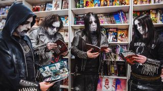 Sons Of Balaur reading Realm Of The Damned in Forbidden Planet