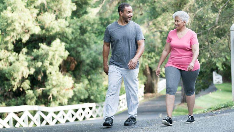Man and woman out for a stroll during their 30-day walking challenge