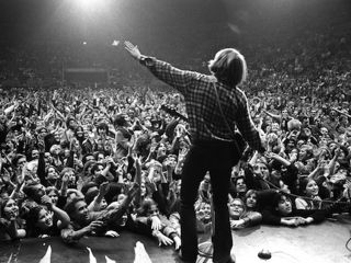 John Fogerty on stage with CCR at the Oakland Coliseum Arena Oakland CA 1970