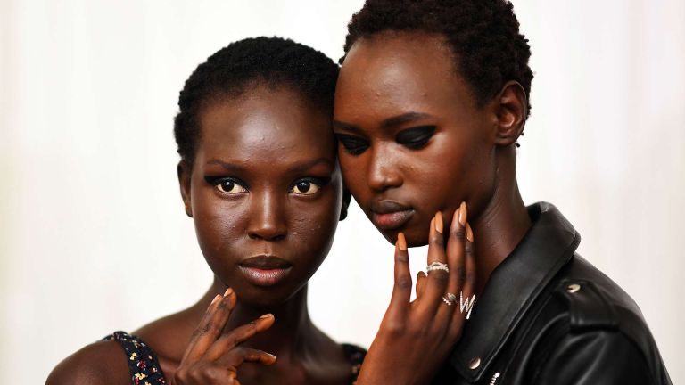 Two models with glowing skin backstage at the 3.1 Philip Lim show in New York