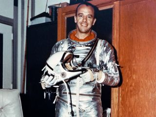 Astronaut Alan Shepard, the first American in space, poses here in his Mercury flight suit.