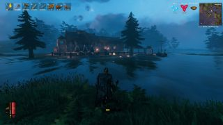 Valheim screenshot showing character viewing a Viking hall and dock