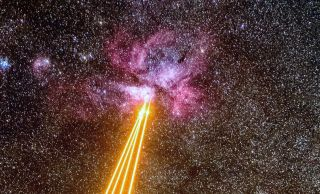 Lasers fly through space toward the glowing Carina Nebula