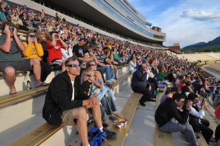 Observers gaze up at the annular solar eclipse on May 20, 2012 at a special event held at the University of Colorado's Folsom Field football stadium in Boulder, Colo.