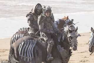 Actors in bony armor on horseback