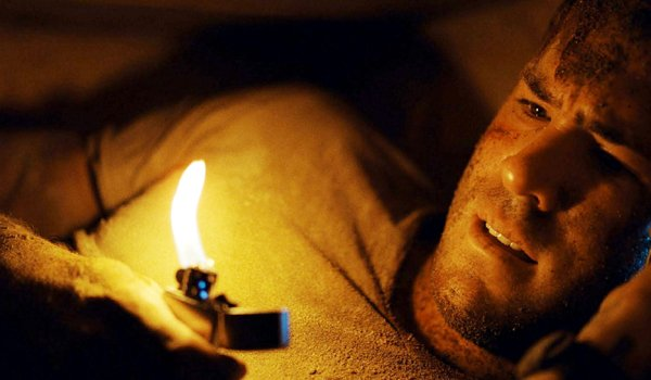 Buried Ryan Reynolds trapped with lighter