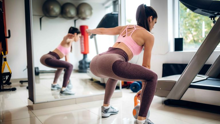 Home gym: Getty image of woman working out in home gym