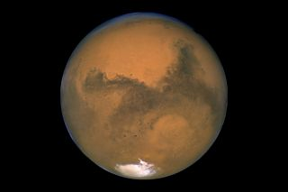 "Mars, the Red Planet, may seem beyond reach in this view from NASA's Hubble Space Telescope in 2003. But the space company Uwingu has launched a ""Beam Me to Mars"" project to let the public send messages to the Red Planet in order to raise funds for space"
