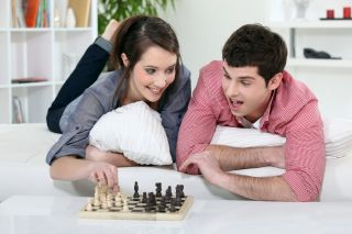 A couple plays chess