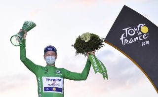 Team Deceuninck rider Irelands Sam Bennett celebrates on the podium after winning the best sprinters green jersey of the 107th edition of the Tour de France cycling race after the 21st and last stage of 122 km between ManteslaJolie and Champs Elysees Paris on September 20 2020 Photo by AnneChristine POUJOULAT AFP Photo by ANNECHRISTINE POUJOULATAFP via Getty Images