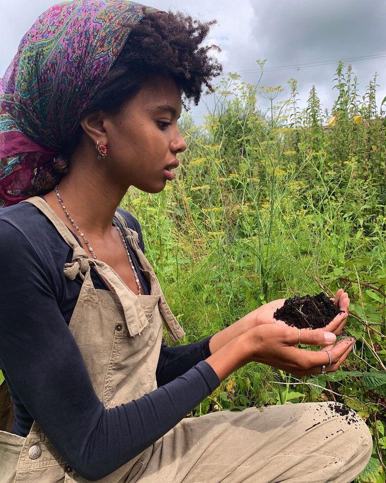 Poppy Okotcha in her garden