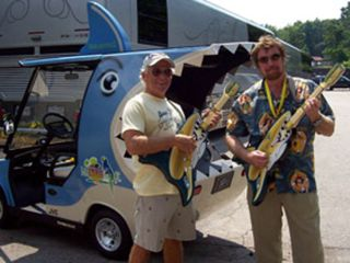 Jimmy Buffett and Hartley Peavey go tooth to tooth