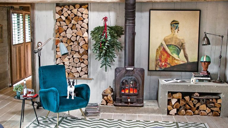 Cozy living room with log pile and wood burning stove