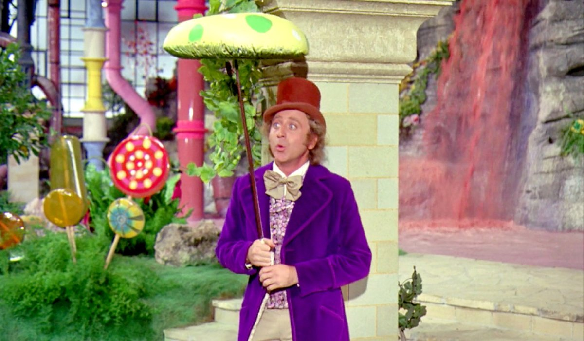 Willy Wonka & the Chocolate Factory Gene Wilder in costume, holding a candy mushroom